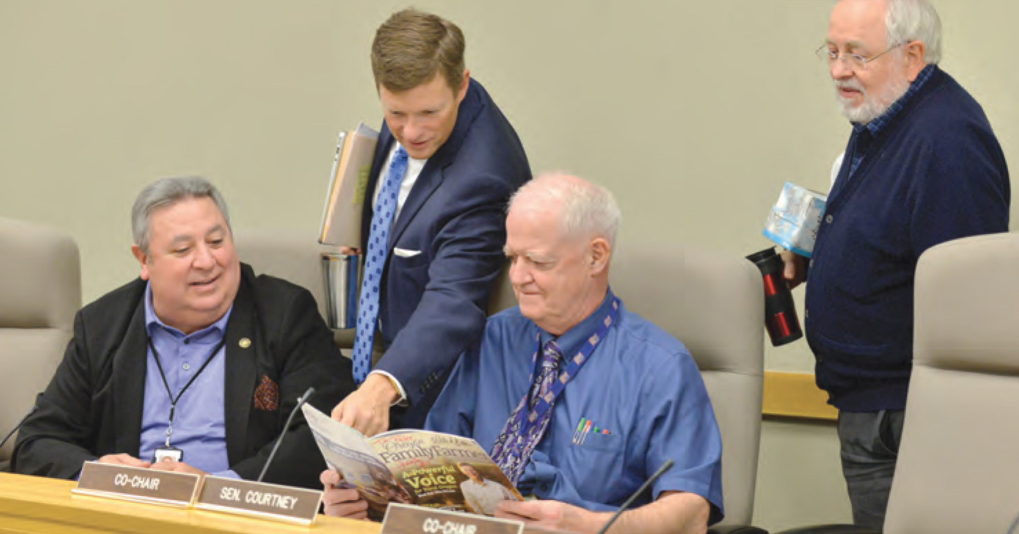 (Left to Right) Former Senate Minority Leader Ted Ferrioli, House Minority Leader Mike McLane, Senate President Peter Courtney, and House Revenue Chair Representative Phil Barnhart take a look at McLane's cover article in the Fall 2017 issue.